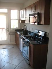 cuisine classique(0.0), wood flooring(0.0), floor(1.0), kitchen(1.0), countertop(1.0), room(1.0), property(1.0), interior design(1.0), real estate(1.0), hardwood(1.0), cabinetry(1.0),
