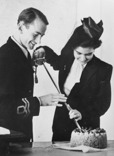 Lena Cohn and Tony Cansdale cut their wedding cake, 1947