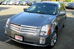 cadillac sts(0.0), automobile(1.0), automotive exterior(1.0), sport utility vehicle(1.0), executive car(1.0), cadillac(1.0), wheel(1.0), vehicle(1.0), compact sport utility vehicle(1.0), crossover suv(1.0), bumper(1.0), land vehicle(1.0),