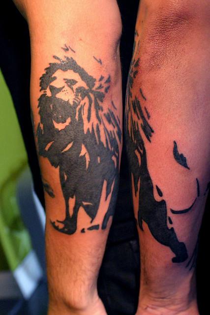 graphic lion tattoo