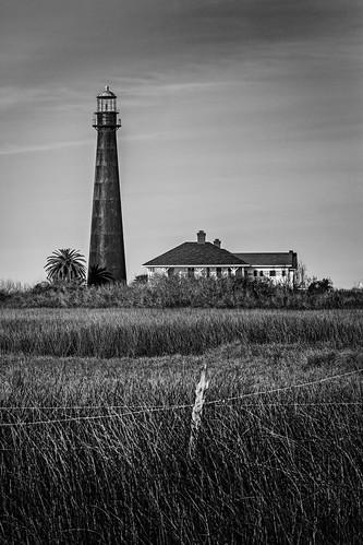 bw barbedwire blackwhite blackandwhite boivarpoint fence grass house houses light lighthouse monochrome pointbolivarlight pointbolivarlighthouse bolivarpeninsula texas unitedstates us