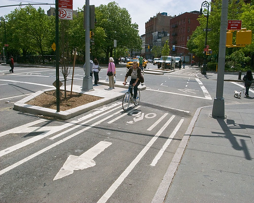 Protected bike lane through intersection
