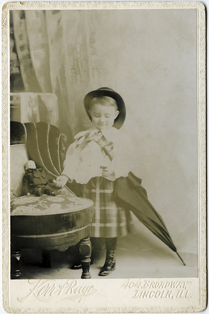 Cabinet Portrait of a Young Boy in a Dress With Doll and Umbrella