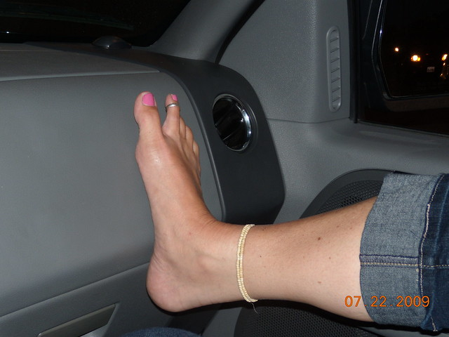 Female Feet Resting On Dashboard