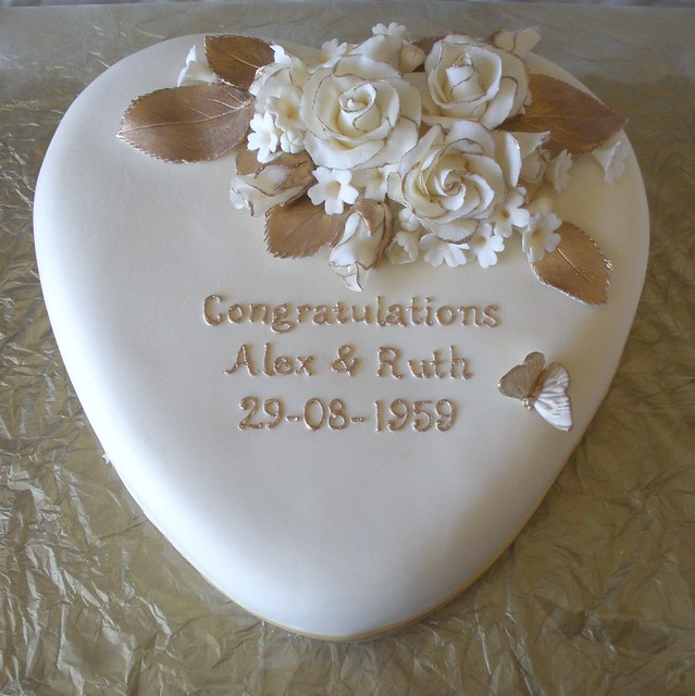 For a 50th wedding anniversary Roses are edged with gold and filler flowers