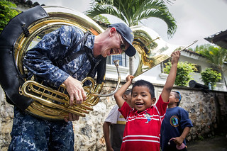 Sailor plays with host nation children during Continuing Promise 2017's.