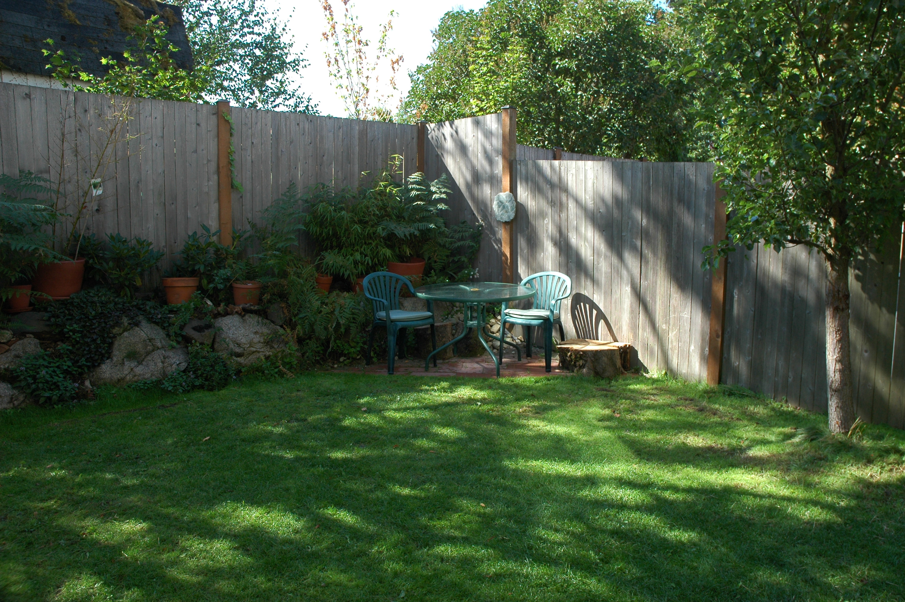 Small triangular patio in the backyard of a northend ...
