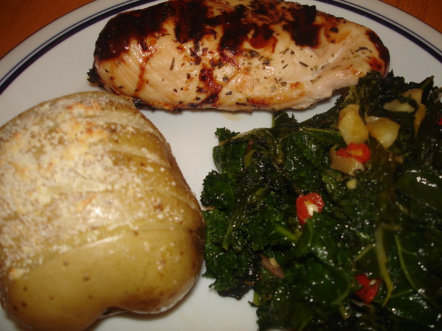 herb chicken with parmesan baked potato and spicy garlic kale ...