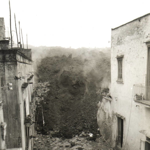 Lava flow engulfing a village to the west of Vesuvius, 1944