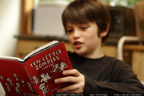"one little boy reading ""ten little zombies"""