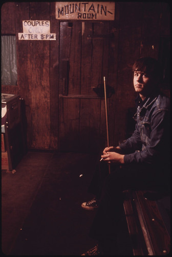 Robert Johnson, 18, Sits on a Pool Table in a Beer Joint in Clothier, West Virginia, near Madison. He Has Passed a Job Physical and Is Waiting to Go to Work in the Mines 04/1974