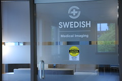 Frosted glass door, Logo, Swedish Medical Imaging, Caution Automatic Door, Two way traffic, sign, Ballard, Seattle, Washington, USA