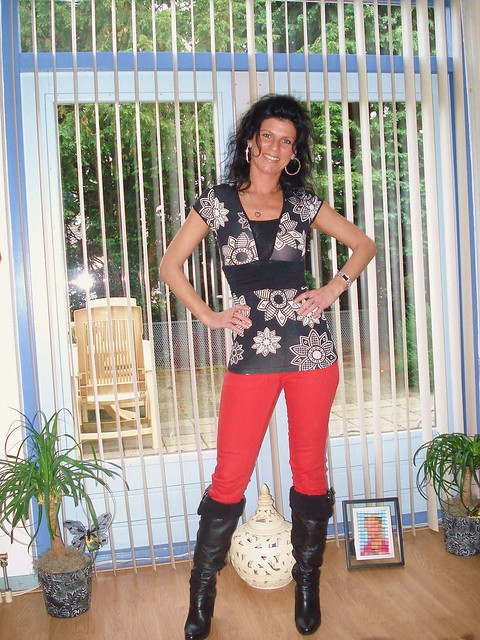 Red pants, black boots milf