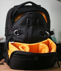 handbag(0.0), leather(0.0), bag(1.0), orange(1.0), yellow(1.0), backpack(1.0),