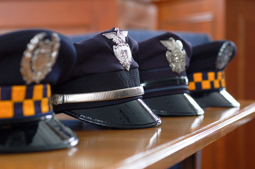 Four uniform hats
