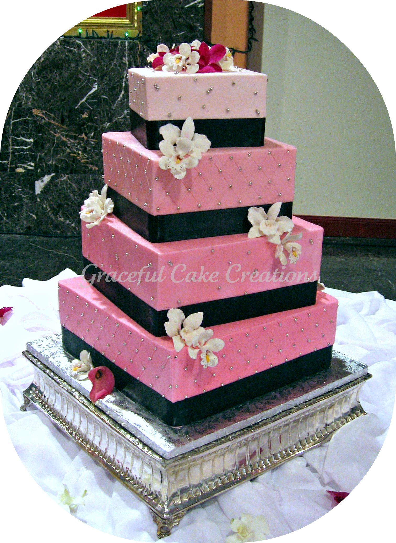 ivory wedding cake with pink flowers