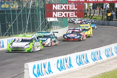 dirt track racing(0.0), touring car(0.0), auto racing(1.0), racing(1.0), sport venue(1.0), vehicle(1.0), stock car racing(1.0), sports(1.0), race(1.0), race of champions(1.0), motorsport(1.0), rallycross(1.0), race track(1.0),