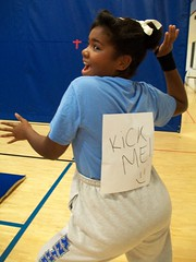 girl with Kick Me! sign on her back
