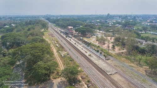 aerial photography view architecture building exterior city cityscape day high angle highway no people old buildings town outdoors rail transportation railroad station platform track road sky train tree urban skyline