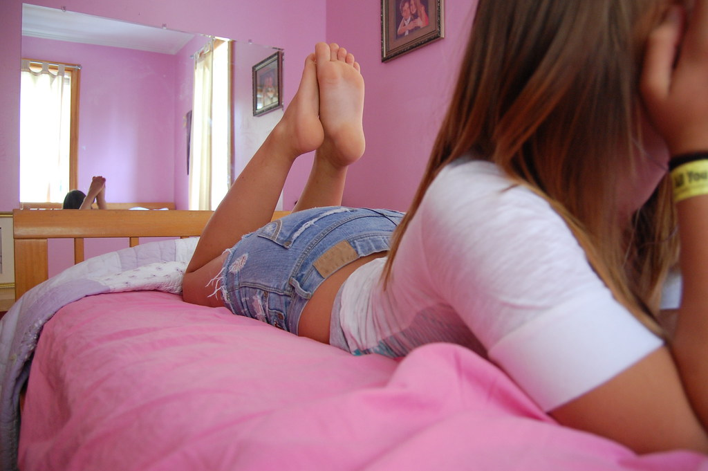 Teen girl feet soles