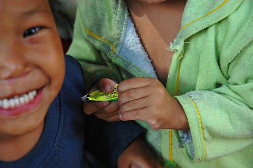 Happiness! Nepalese Kids with candy, the one on the right had heart surgery, Boudha, Kathmandu, Nepal by Wonderlane