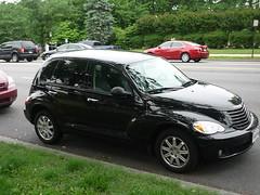 minivan(0.0), automobile(1.0), automotive exterior(1.0), executive car(1.0), wheel(1.0), vehicle(1.0), compact sport utility vehicle(1.0), chrysler pt cruiser(1.0), rim(1.0), city car(1.0), chrysler(1.0), land vehicle(1.0), luxury vehicle(1.0),