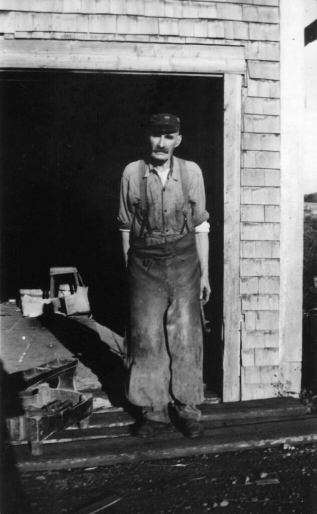 George Davidson outside his blacksmith shop