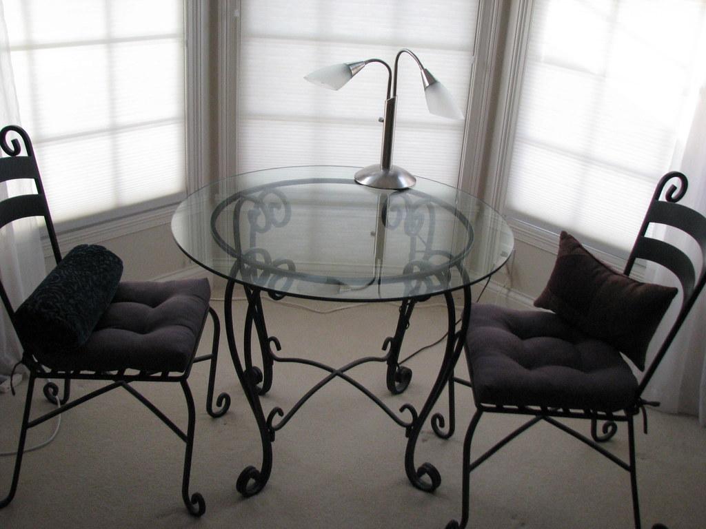 custom glass table & iron chairs $300
