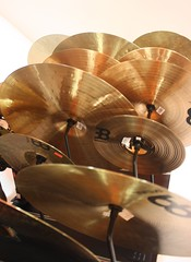 wood(0.0), drums(0.0), drum(0.0), brown(1.0), musical instrument(1.0), close-up(1.0), cymbal(1.0),