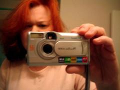 instant camera(0.0), selfie(1.0), hand(1.0), cameras & optics(1.0), digital camera(1.0), camera(1.0), eye(1.0),