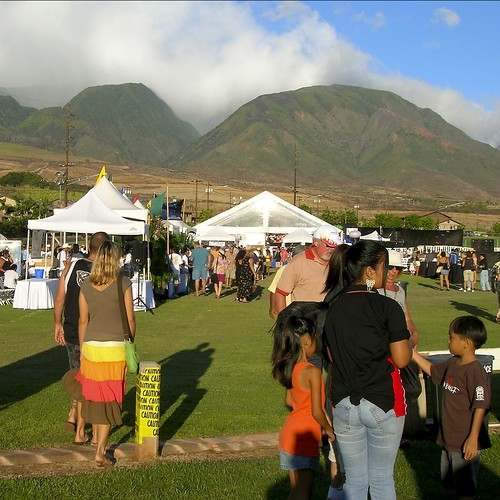 Residents and visitors alike enjoy an outdoor summer festival.