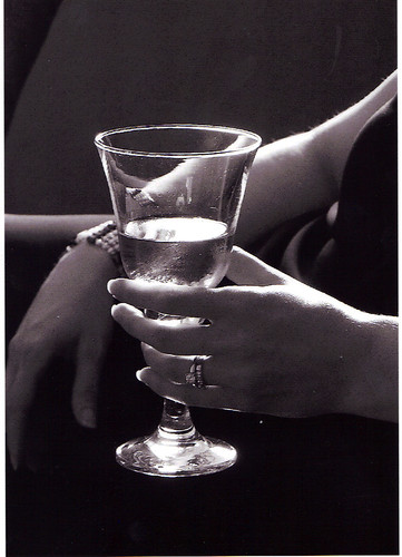 photo of hands and a wine glass
