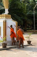 Monks re-decorating, Vientiane, Laos