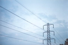outdoor structure(0.0), mast(0.0), tower(0.0), electrical supply(1.0), overhead power line(1.0), line(1.0), wind(1.0), transmission tower(1.0), electricity(1.0), antenna(1.0),