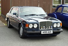 rolls-royce silver spirit(0.0), performance car(0.0), bentley arnage(0.0), bentley(0.0), convertible(0.0), automobile(1.0), automotive exterior(1.0), rolls-royce camargue(1.0), vehicle(1.0), rolls-royce silver seraph(1.0), sedan(1.0), land vehicle(1.0), luxury vehicle(1.0),
