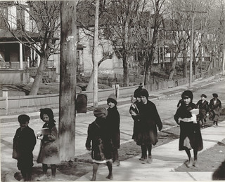 A group of children in winter coats walking to or from school