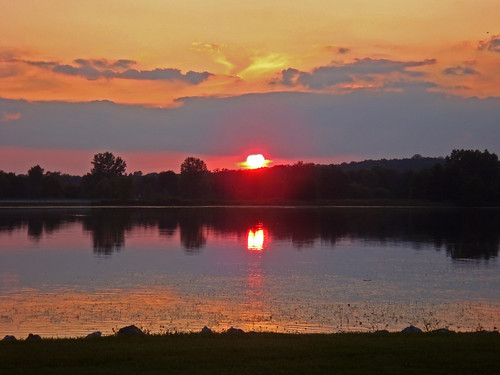 park sunset summer orange sun lake reflection water michigan stonycreekmetropark washingtontownship