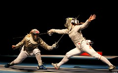 wrestler(0.0), foil(0.0), weapon combat sports(1.0), fencing weapon(1.0), weapon(1.0), sabre(1.0), sports(1.0), ã‰pã©e(1.0), fencing(1.0), performance art(1.0),