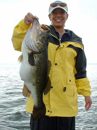 Lake toho orlando florida women catch big florida bass for Florida lake fish