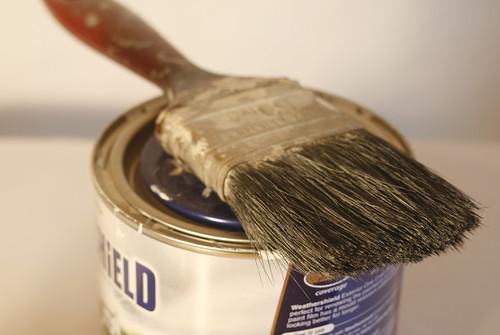 paintbrush sat on tin