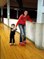 mother teaching son to roller skate   PB280053