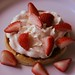 Waffle with strawberries and whipped cream.