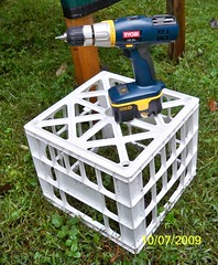 Sukkah Toolkit: A cordless power drill, and a milk crate