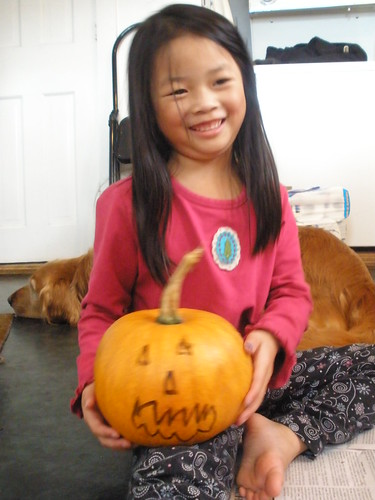 Olivia with Pumpkin She Drew