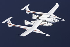WhiteKnightOne and SpaceShipOne in flight, Oshkosh, WI. Credit Jim Koepnick.