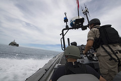 Boatswain's Mate 2nd Class Ryan Leach, right, and Chief Gunner's Mate Adan Macias approach USS Coronado (LCS 4) during training with the Royal Brunei Navy in the South China Sea, Feb. 19.  (U.S. Navy/MC2 Amy M. Ressler)
