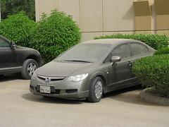 automobile(1.0), automotive exterior(1.0), family car(1.0), wheel(1.0), vehicle(1.0), honda(1.0), compact car(1.0), bumper(1.0), honda civic hybrid(1.0), sedan(1.0), land vehicle(1.0), honda civic(1.0),