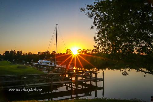 sun sunset rays trees boat sailboat okeechobee waterway okeechobeewaterway nature mothernature dock water stuart florida usa