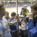 Spectators ask about Zeus, an American Kestrel, as he sits on the hand of U.S. Air Force Academy Cadet 1st Class Justin Weber during a hockey game Jan. 13, 2017. The Academy's falcons perform for 500,000 to 600,000 people each year at sporting events and educational demonstrations nationwide. The first Academy class selected the falcon as its mascot in 1955. (U.S. Air Force Photo/Master Sgt. Brian Ferguson)