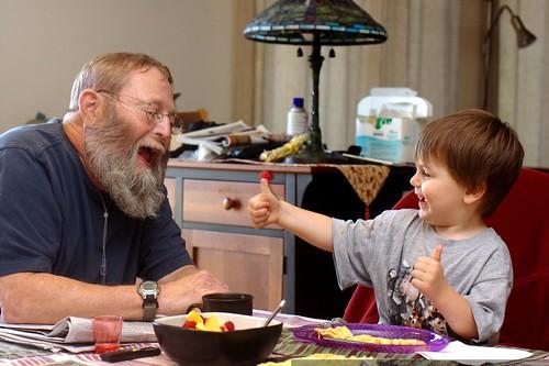 sharing raspberries with grandpa chips at breakfast    MG 1618